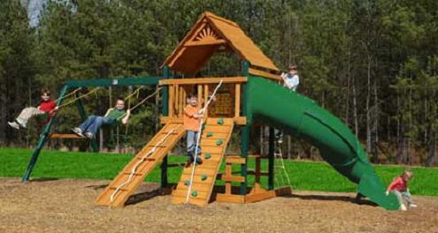 Tube slide swings rock wall tree house