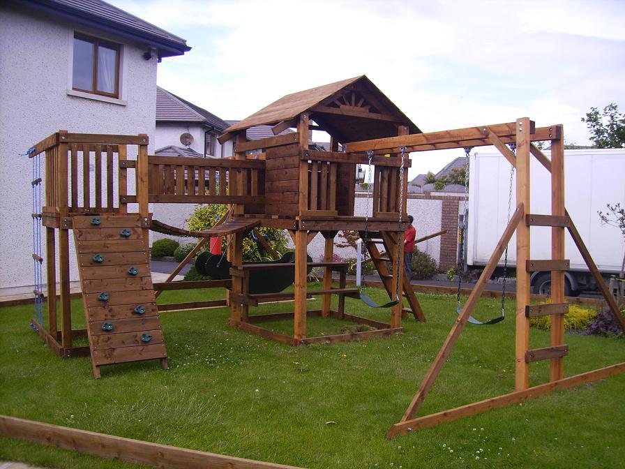 swings slide vertical rockwall monkeybars chain link bridge treehouse climbingnet
