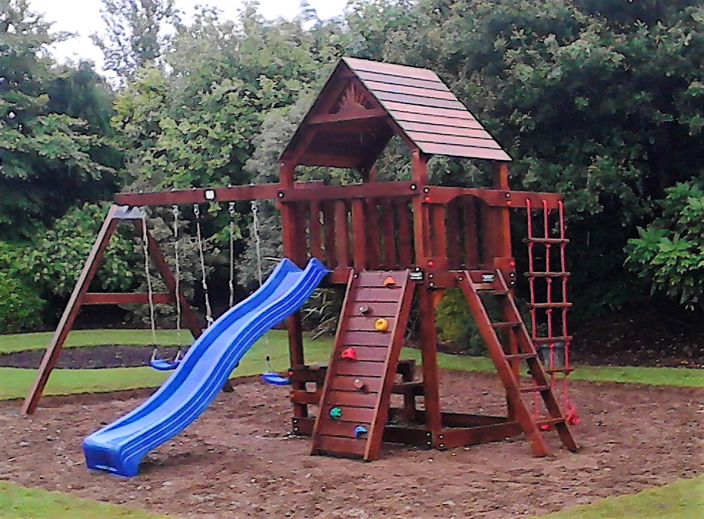 Chateau slide,rock wall, climbing net,swings tree house,picnic table and bench