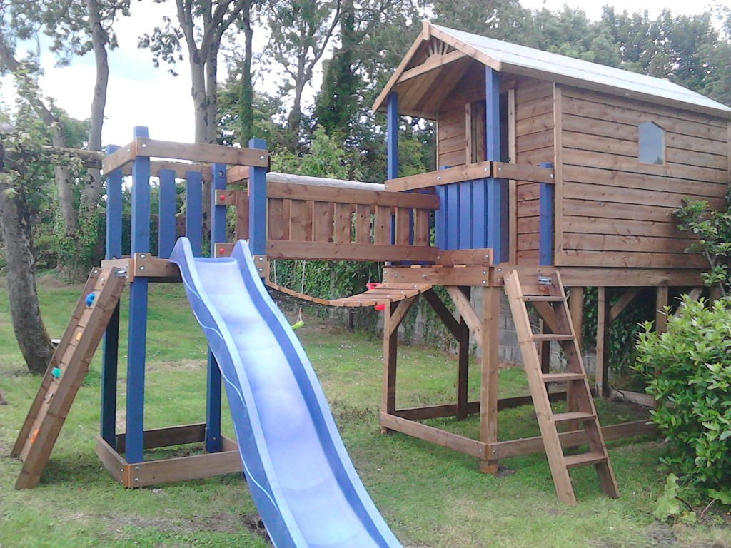 Deluxe tree house bridge link rock wall access ladder slide