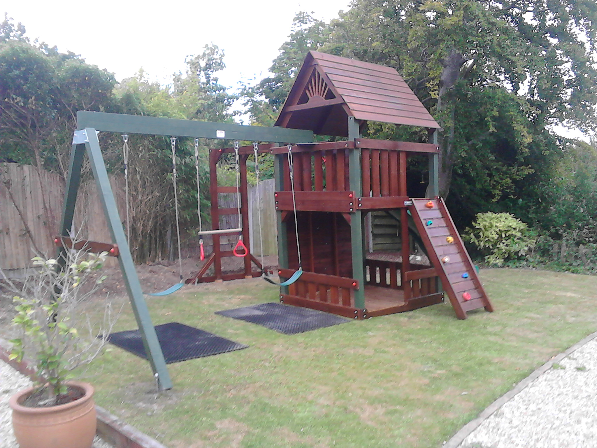 rock wall,monkey bars, swings , 2 story tree house