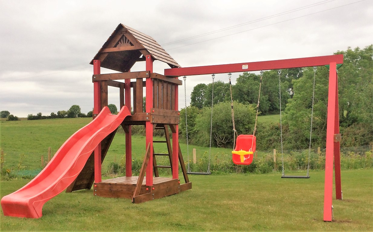 Lydon Playcentre with added sandbox and lid sttswings