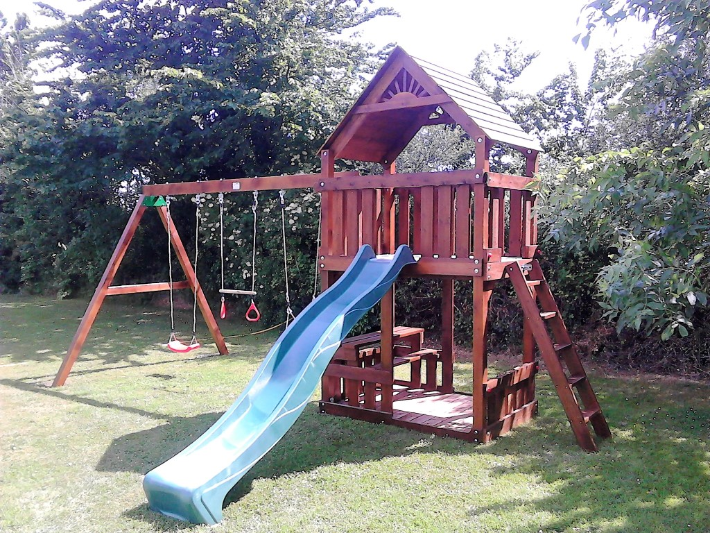 STT Swings climbing frams and playcentres with swings slide rockwall and picnic table with bench