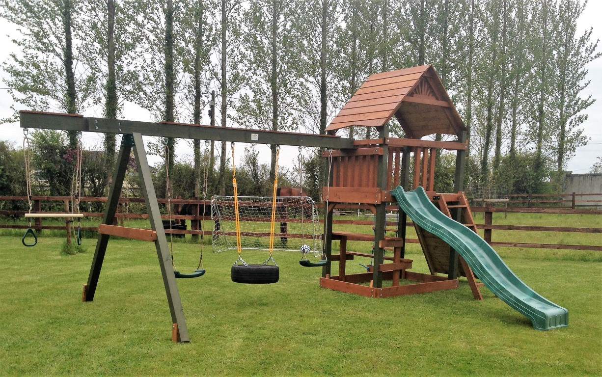 Sarahs place climbing frame swing ans slide tree house sttswings