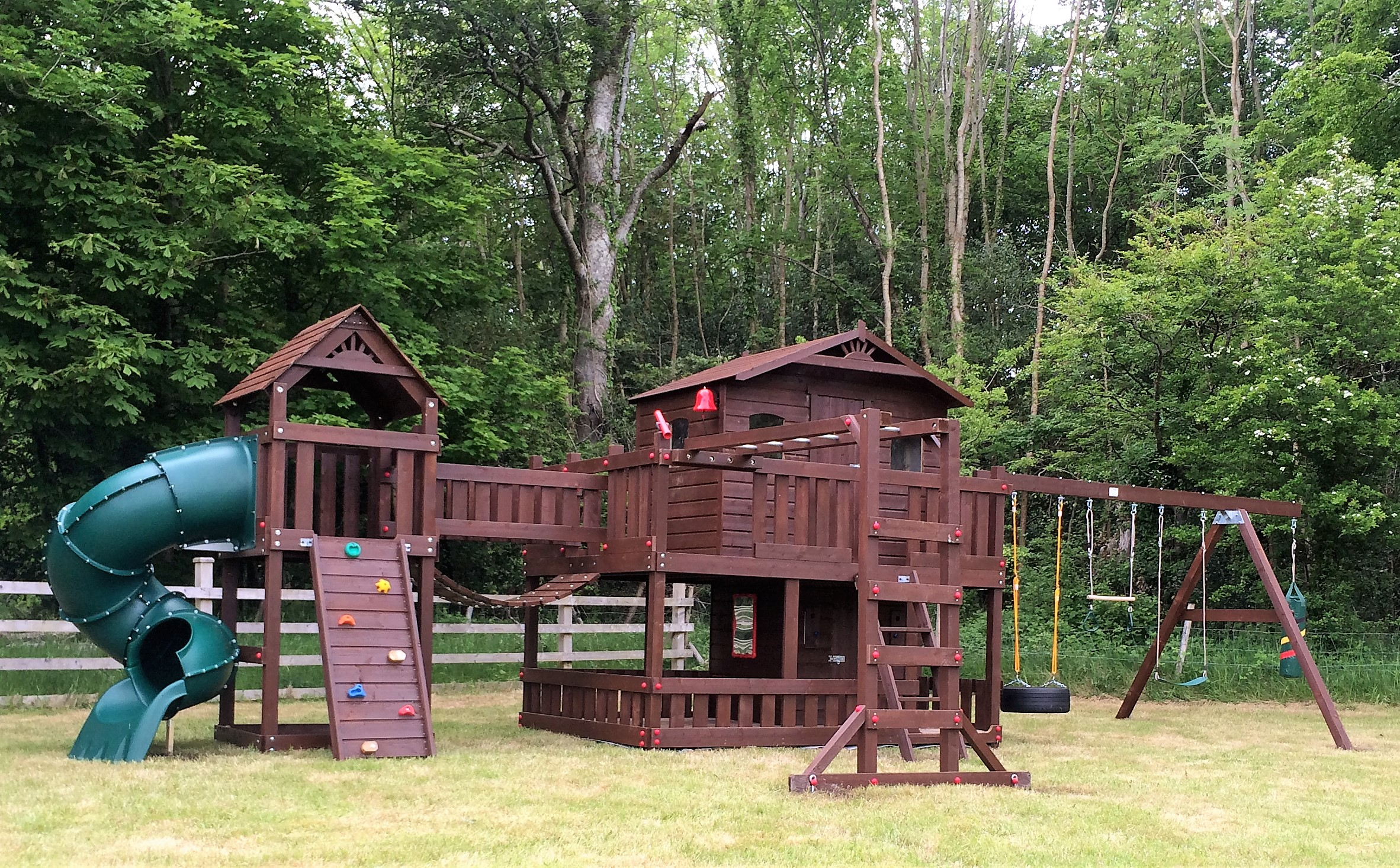 Large tree house,spiral tube slide,monkey bar beam,swing set,